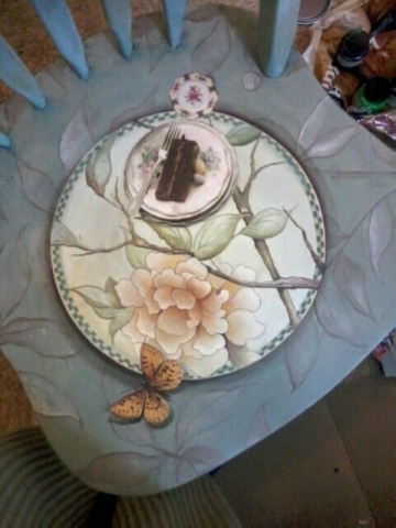 The Chocolate Chair. Floral seat with a slice of chocolate cake