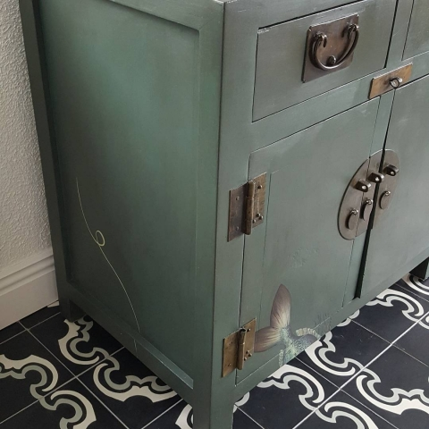 A handpainted painted wooden chest for a coastal home. Using an Antique wash, and copper patina on the fishy scales.
